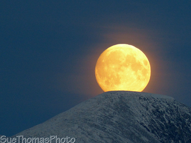 Super moon rising over the mountains